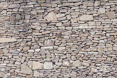 Old grey and brown rough stone wall, closeup texture background, selective focus, shallow DOF Royalty Free Stock Photos