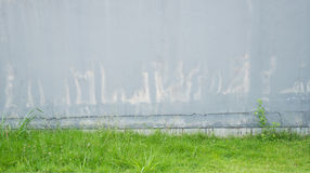 Old grey concrete wall pale and cracked Royalty Free Stock Images