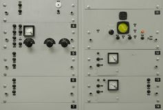 Old, grey electrical control panel. With buttons, switches, fuses, plugs, monitors and numbers, and with some copyspace Royalty Free Stock Photography