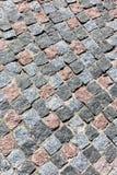 Old grey granite cobblestone pavement background, top view Stock Photo