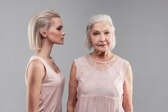 Old grey-haired woman with bob hairstyle looking directly into camera. Beautiful daughter. Old grey-haired women with bob hairstyle looking directly into camera stock photography