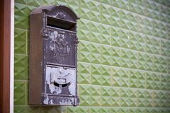 Old Grey Mailbox on a Green Wall Royalty Free Stock Images