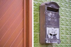 Old Grey Mailbox on a Green Wall Royalty Free Stock Photos