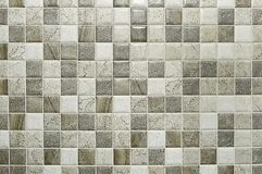 Old grey mosaic stone wall background texture. Close up Royalty Free Stock Images