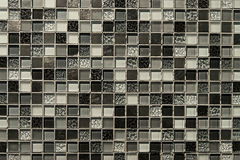 Old grey mosaic wall background texture Royalty Free Stock Photos