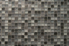 Old grey mosaic wall background texture Royalty Free Stock Photo
