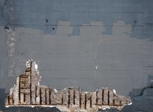 Old grey patched painted concrete wall with corroding rusty steel reinforcement bars causing damage to the structure royalty free illustration