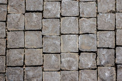 Old grey pavement cobbled road as background Royalty Free Stock Images