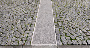 Old grey pavement in a pattern Stock Photography