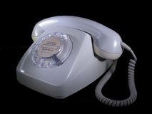 Old grey phone. Isolated on black Royalty Free Stock Photography