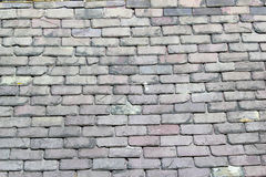 Old grey roof slates or tiles. Stock Photo