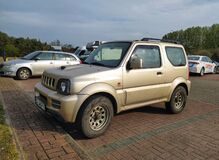 Free Old Grey Silver Suzuki Jimny 4wd Car With Two Doors Parked Stock Photo - 181020100
