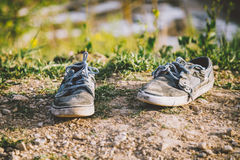 Old grey sneakers Stock Photo