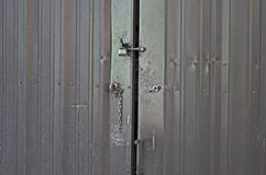 Old grey steel doors with locks Royalty Free Stock Photos