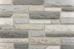 Old grey stone mosaic wall background texture. Close up Royalty Free Stock Images