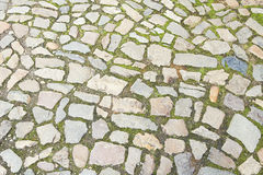 Old grey stone pavement background texture Stock Photo