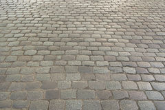 Old grey stone pavement background texture Royalty Free Stock Images