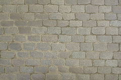 Old grey stone pavement background texture Stock Photos