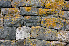Old Grey Stone Wall. With Yellow Lichen Royalty Free Stock Images