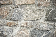 Old grey stone wall background texture Stock Photos