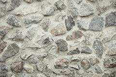Old grey stone wall background texture Stock Photography