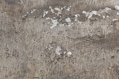 Old grey stucco wall with cracked plaster. Background texture Stock Photo