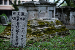 Old grey tombstones. Cemetery in Malaysia Stock Images