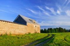 Old grey weathered barn at sunset Stock Photo