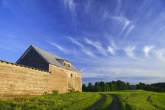 Old grey weathered barn  at sunset Royalty Free Stock Photography