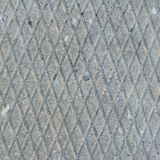 Old grey weathered concrete plate, rough grunge abstract cement tile texture diagonal groove pattern macro closeup, diagonally. Grooved large detailed vertical Royalty Free Stock Photos