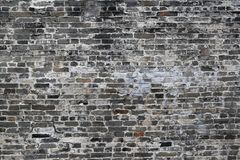 Old Grey And White Antique Brick Wall. An old grey and white antique brick wall royalty free stock photography
