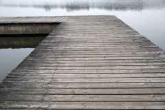 Old grey wood pier by the river picture stock photo