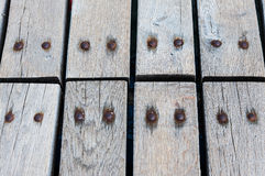 Old grey wooden boardwalk pattern with nails Royalty Free Stock Photo