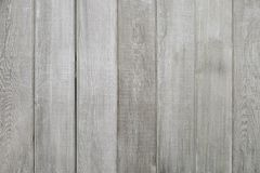 Old grey wooden fence background texture. Close up Stock Photos