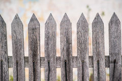 Old grey wooden fence on the wall Royalty Free Stock Image