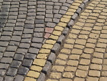 Old grey and yellow stone pavement background Stock Image