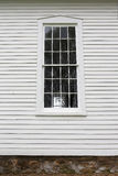Old Grilled Window Pains and Wood Siding on Historic Little Whit Stock Photography