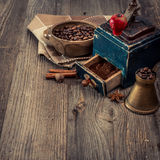 Old grinder and coffee beans Stock Photos