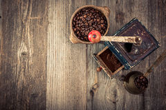 Old grinder and coffee beans Stock Photo