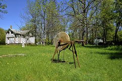 Old grindstone on the grass Stock Images