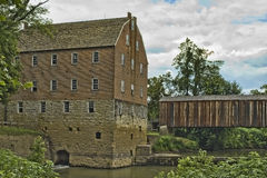 Old Grist Mill and Covered Bridge stock photos