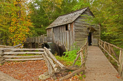 Old grist mill in the fall. Stock Image