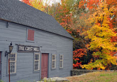 Old Grist Mill and Foliage. Old grist mill building and brilliant foliage in Townsend, Massachusetts royalty free stock images