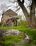 Old Grist Mill. An old grist mill beside a small stream Stock Photography