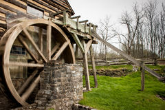 Old Grist Mill. An old grist mill beside a small stream Royalty Free Stock Images
