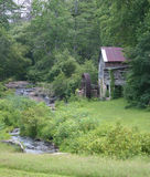 Old Creekside Mill. An old gristmill next to a small stream royalty free stock image