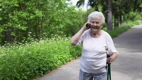 White haired Granny talking on the phone with family stock video