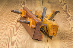 Old grooving plane. On a wooden board Royalty Free Stock Photos