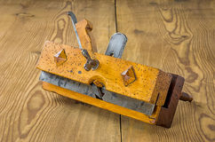 Old grooving plane. On a wooden board Stock Images