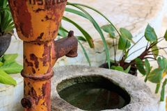 Old groundwater pump. In a garden, Closeup stock photography